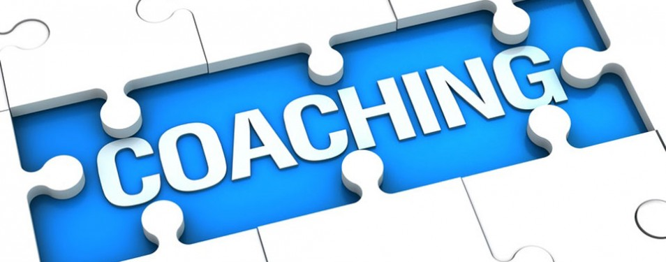 """A puzzle board reading: """"Coaching"""""""